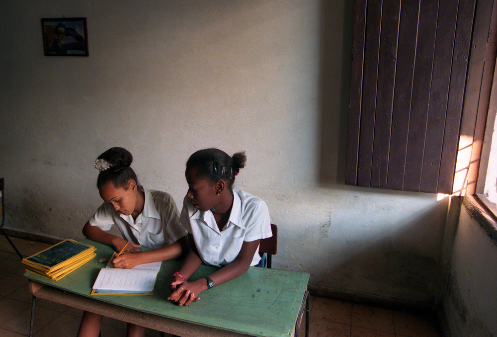 Students take notes in a window-lit classroom at the Abraham Lincoln Elementary School in Havana, Cuba, October 1999. File/The State Journal-Register/T.J. Salsman