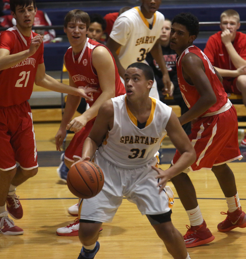 Spartans player Harrison Devoe looks to score during first half action. The Springfield Southeast High School Spartans defeated the Jacksonville High School Crimsons 60-36 in boys basketball action at the Spartans gym on Friday, Dec. 19, 2014. David Spencer/The State Journal-Register