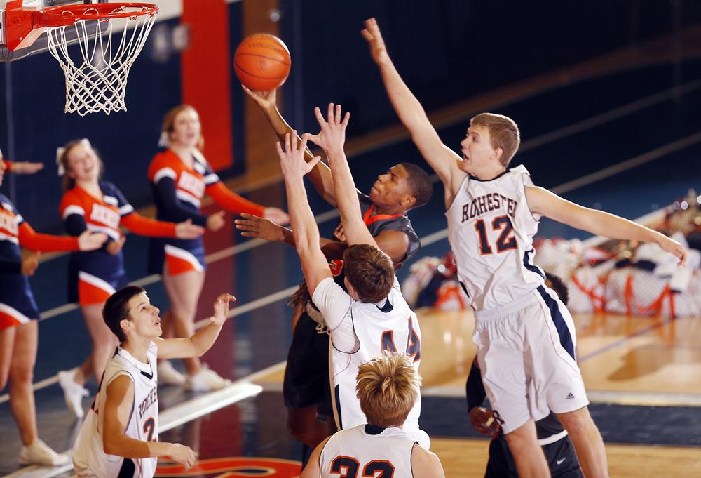 Lanphier's Xavier Bishop slips through the Rochester defense at Rochester High School Saturday, Dec. 20, 2014. Ted Schurter/The State Journal-Register