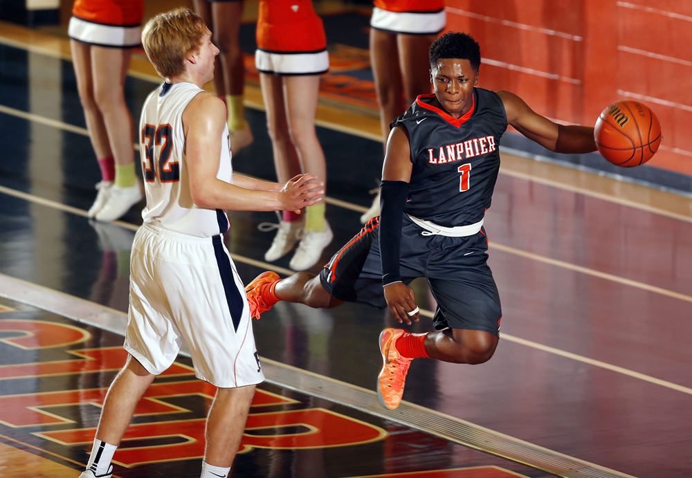 Lanphier's Yaakema Rose saves the balll as he flies out of bounds against Rochester at Rochester High School Saturday, Dec. 20, 2014. Ted Schurter/The State Journal-Register