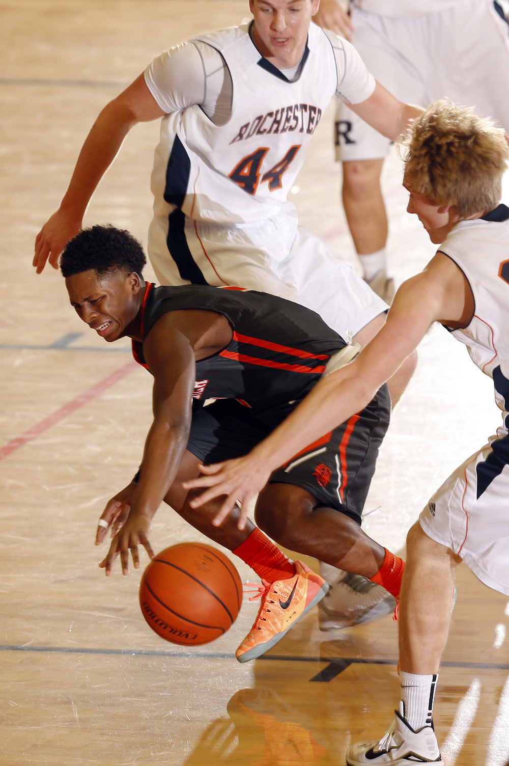 Lanphier's Yaakema Rose looses control of the ball in between two Rochester defenders at Rochester High School Saturday, Dec. 20, 2014. Ted Schurter/The State Journal-Register