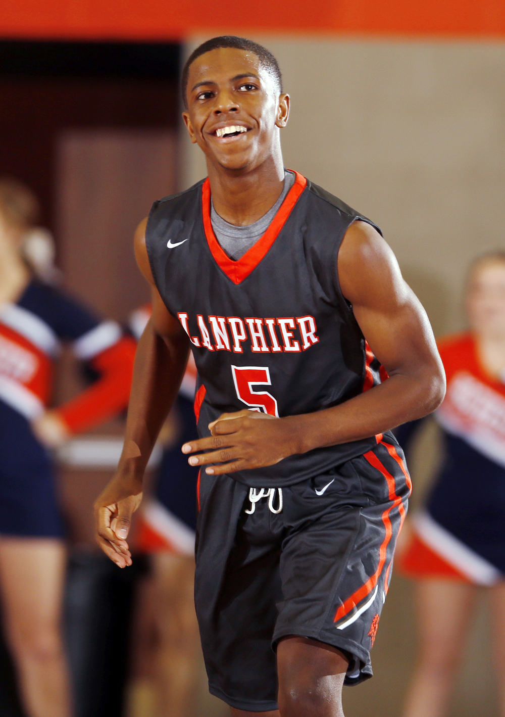 Lanphier's Xavier Bishop is all smiles after dropping a three on Rochester at Rochester High School Saturday, Dec. 20, 2014. Ted Schurter/The State Journal-Register