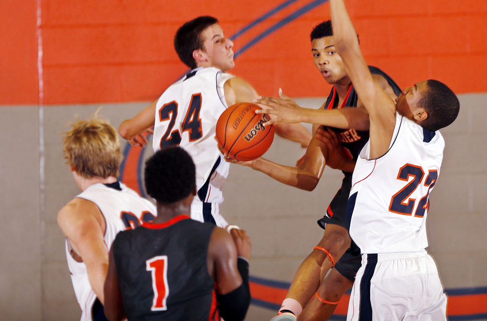 Lanphier's Cardell McGee slips between the Rochester defense under the hoop at Rochester High School Saturday, Dec. 20, 2014. Ted Schurter/The State Journal-Register
