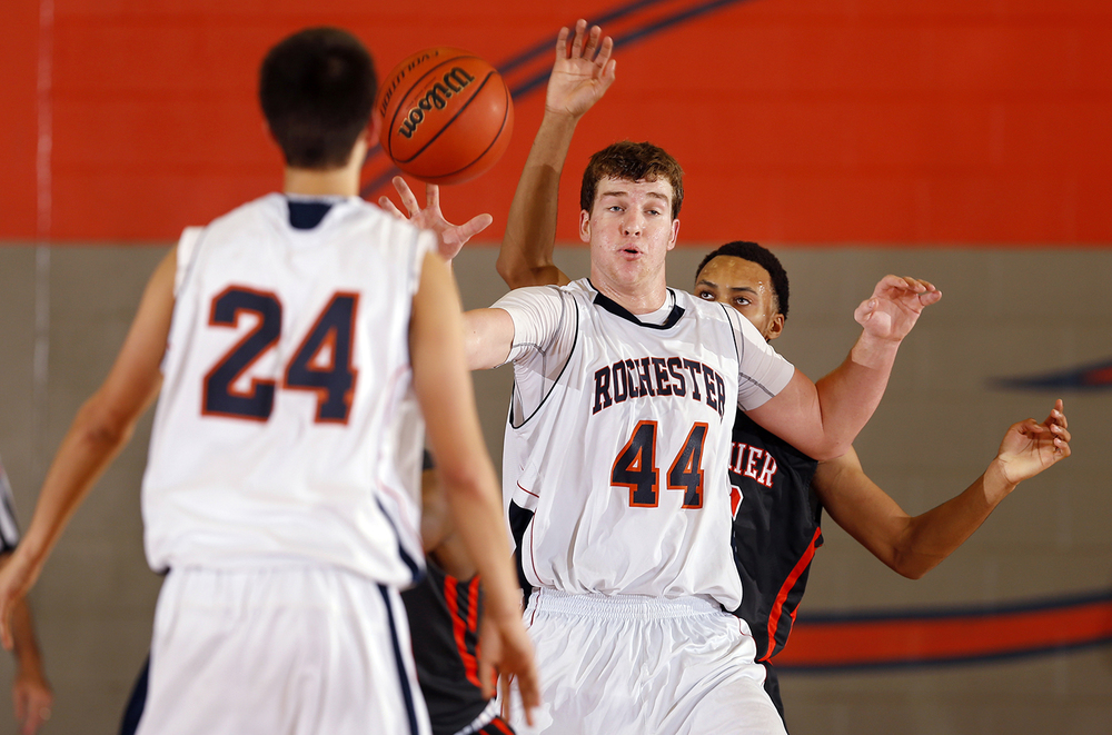 Rochester's Adam Conrady takes a pass under the hoop from teammate Howard Fisher at Rochester High School Saturday, Dec. 20, 2014. Ted Schurter/The State Journal-Register