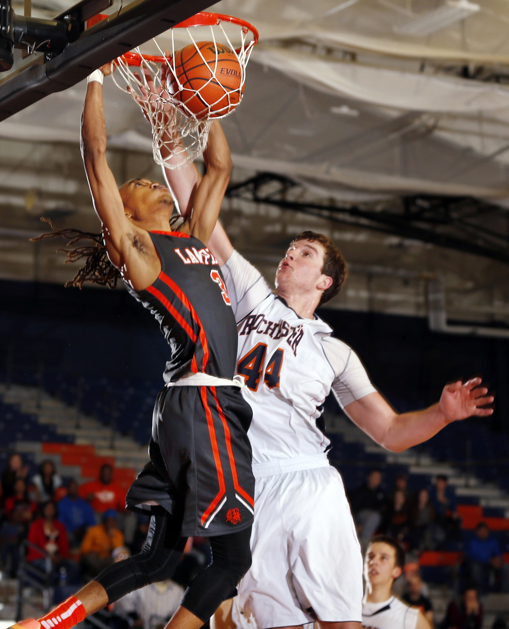 Lanphier's Aarin Thames slams home two points in front of Rochester's Adam Conrady at Rochester High School Saturday, Dec. 20, 2014. Ted Schurter/The State Journal-Register