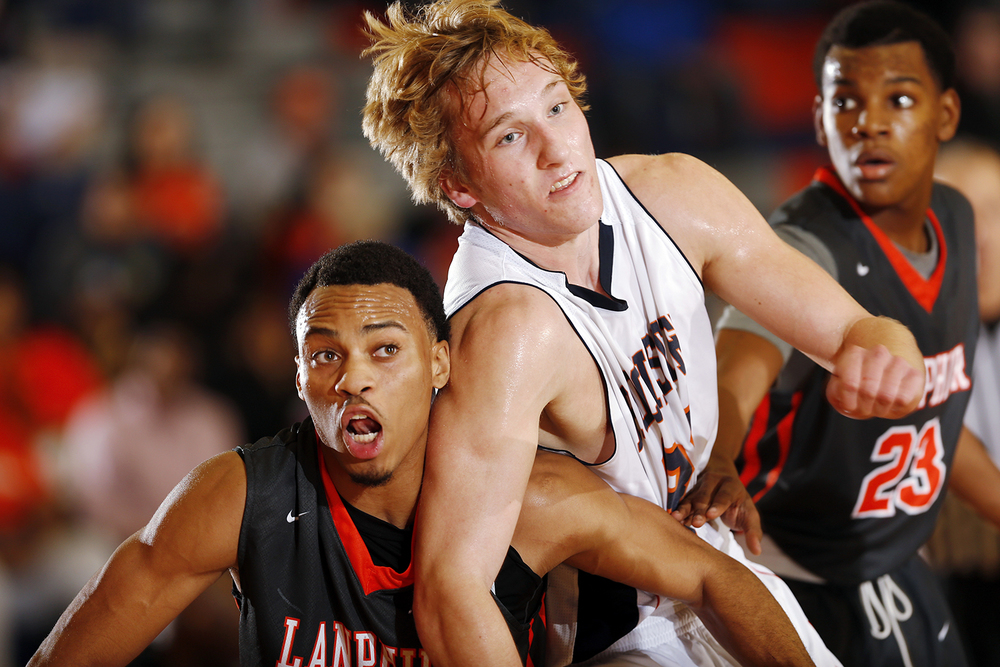 Lanphier's Daryl Jackson, left, and Rochester's Tristan Sutker jockey for position at Rochester High School Saturday, Dec. 20, 2014. Ted Schurter/The State Journal-Register