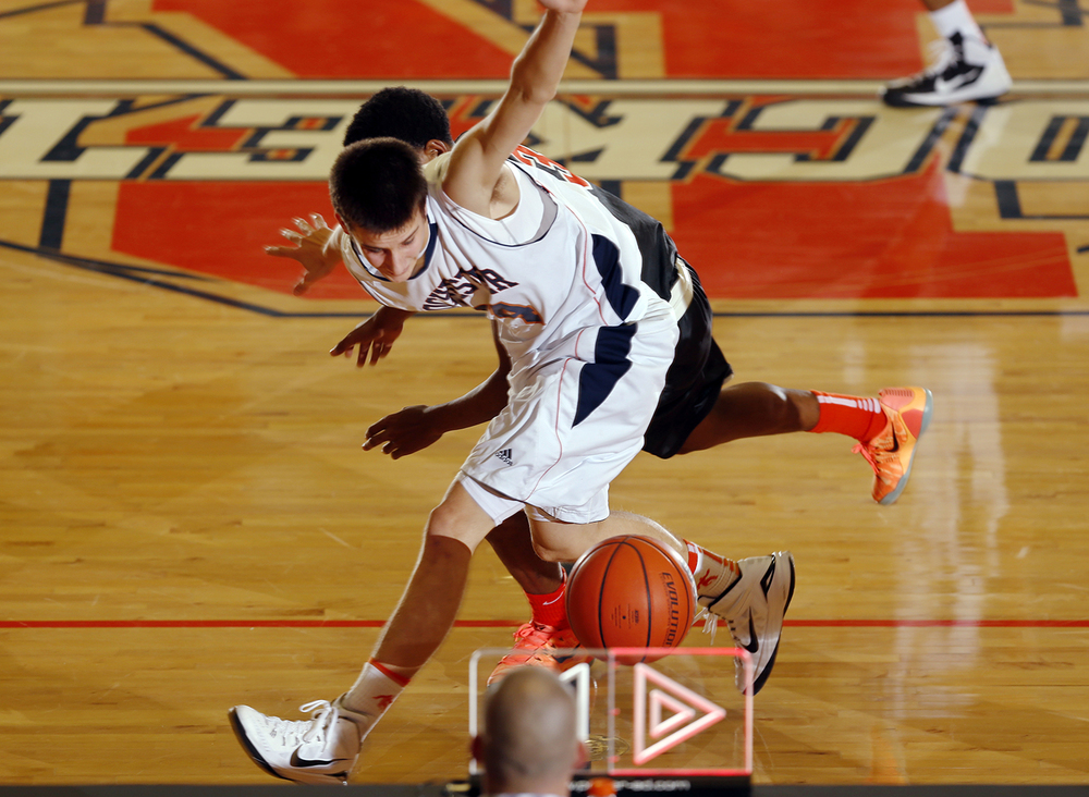 Rochester's Howard Fisher shields the ball from a Lanphier defender as it bounces out of bounds at midcourt at Rochester High School Saturday, Dec. 20, 2014. Ted Schurter/The State Journal-Register