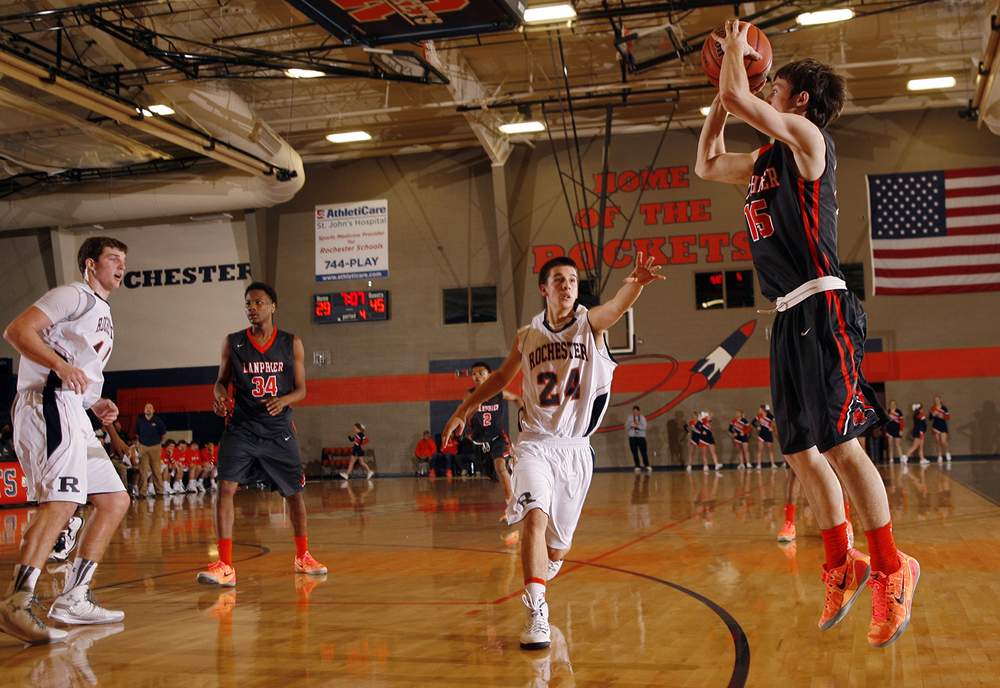 Lanphier's Nick Patton launches a three against Rochester at Rochester High School Saturday, Dec. 20, 2014. Ted Schurter/The State Journal-Register