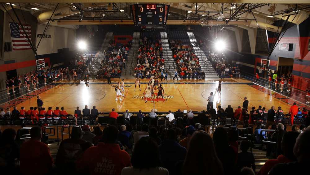 Lanphier and Rochester tip off at Rochester High School Saturday, Dec. 20, 2014. Ted Schurter/The State Journal-Register