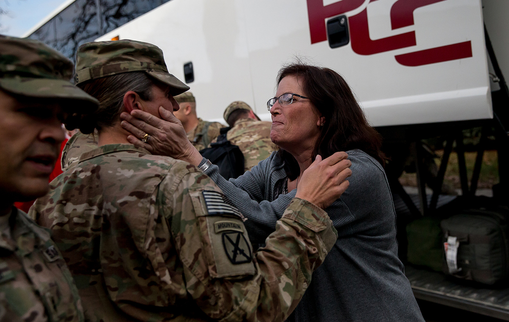 Anita Yakle, right, with the family assistance center at Camp Lincoln, greets Sgt. 1st Class Stacey Long after getting off the bus during a homecoming ceremony for the Illinois Army National Guard's Bilateral Embedded Staff Team (BEST) A13 at Camp Lincoln, Friday, Dec. 19, 2014, in Springfield, Ill. Justin L. Fowler/The State Journal-Register