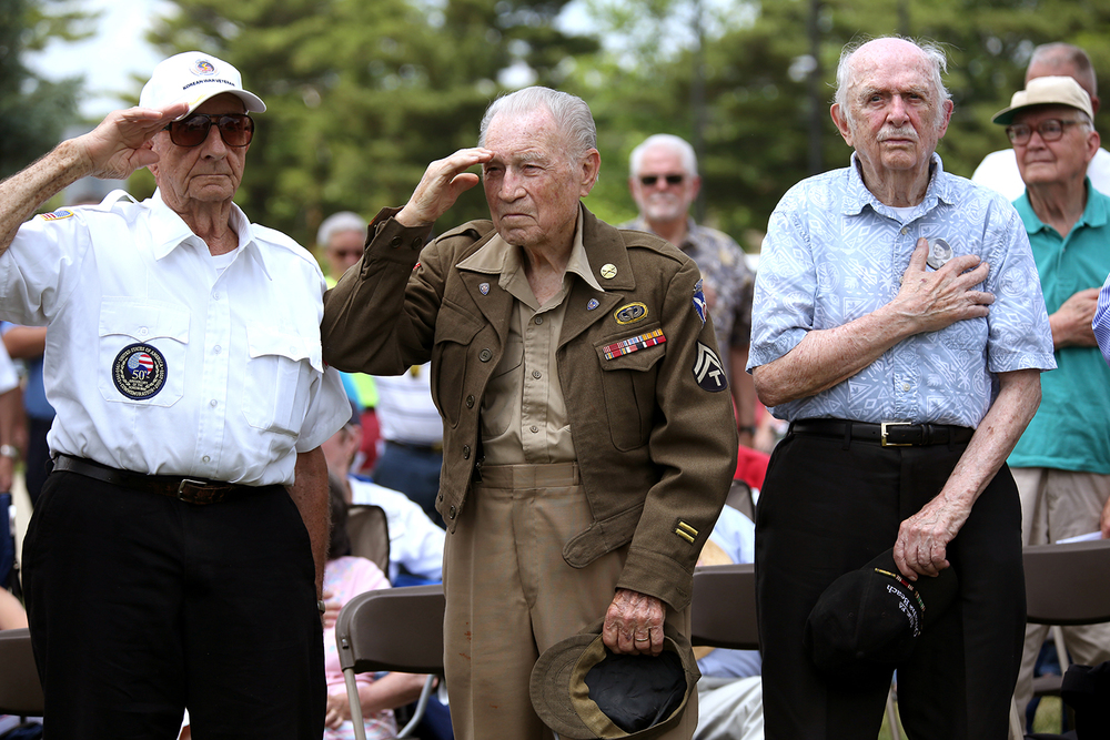 Korean War veteran George Pempek, left, World War II veterans, James Hofstetter of the Pacific theater and Joe Flynn who landed at Omaha Beach during the D-Day invasion, were among the several veterans honored Friday, June 6, 2014 during a ceremony marking the 70th anniversary of the Allied invasion at Normandy, France. The event took place at the Illinois World War II Memorial in Oak Ridge Cemetery. Rich Saal/The State Journal-Register