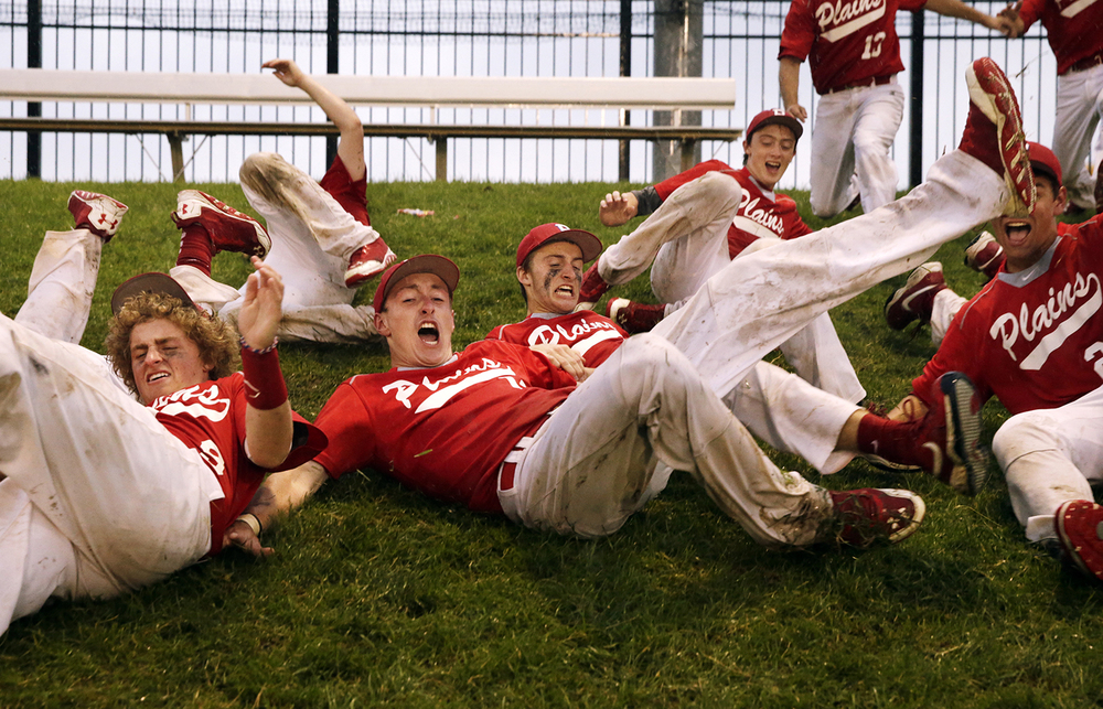 The Pleasant Plains Cardinals slide down a hill at Dozer Park in Peoria after defeating Byron during the Class 2A boys championship game Saturday, June 7, 2014. Ted Schurter/The State Journal-Register
