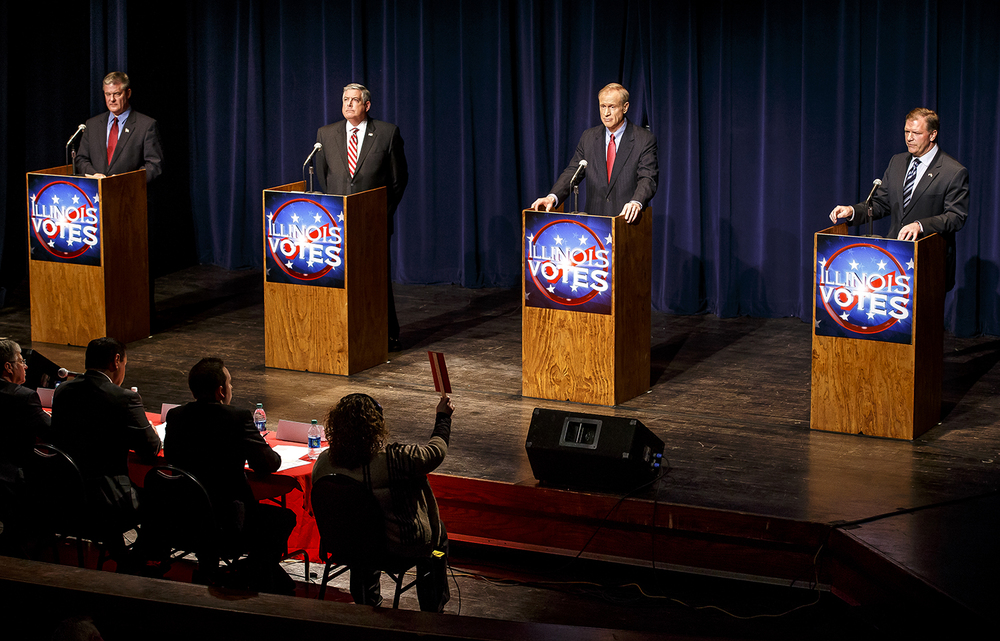 A timer, center, notifies Sen. Bill Brady, right, that his time is up for answering a question during a forum for Republican gubernatorial candidates hosted by the Citizens Club of Springfield at the Hoogland Center for the Arts, Tuesday, Feb. 18, 2014, in Springfield, Ill. The candidates were (from left to right) State Treasurer Dan Rutherford, Sen. Kirk Dillard, businessman Bruce Rauner, and state Sen. Bill Brady. Justin L. Fowler/The State Journal-Register