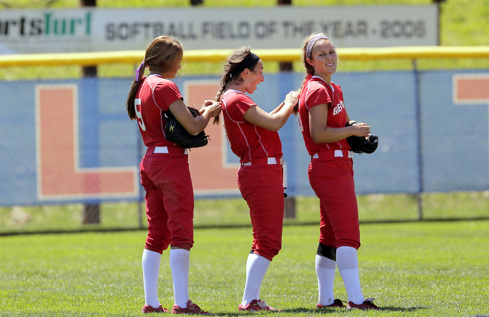 Chatham Glenwood's Madi Torry, left, adjusts Alexa Brown's hair as she adjusts Abby Burton's hair in between innings during the Titans' win against Chicago St. Ignatius during the Class 3A softball semifinals at the Eastside Centre in East Peoria Friday, June 13, 2014. Ted Schurter/The State Journal-Register