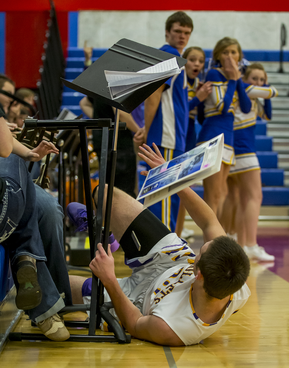 Williamsville High School's Jacob Lounsberry crashes into the Williamsville band section during the Sangamon County Boys Basketball Tournament at Lincoln Land Community College's Cass Gymnasium, Monday, Jan. 13, 2014. Justin L. Fowler/The State Journal-Register