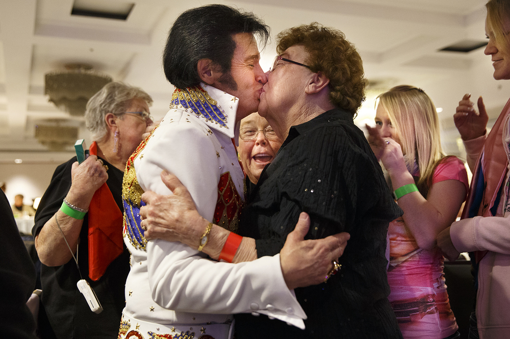 Delores Ross of Virden smooches Paul Hunt of Schenectady, NY during intermission at the 18th Annual Midwest Tribute to the King Competition at the Hilton Springfield Sunday, Feb. 9, 2014. Ross met Hunt at the show years ago and became a member of his unofficial fan club. Hunt won the People's Choice Award. Ted Schurter/The State Journal-Register