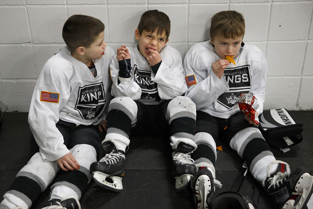 Noah Romack, left, watches Springfield Kings Mite teammate Elliott Fifer wiggle his loose tooth as Ryne Loehr snacks before they play a game at the Springfield Youth Hockey Association Jamboree at the Nelson Center Saturday, Feb. 15, 2014. More than 250 players, coaches and family members participated in the all day event.   Ted Schurter/The State Journal-Register
