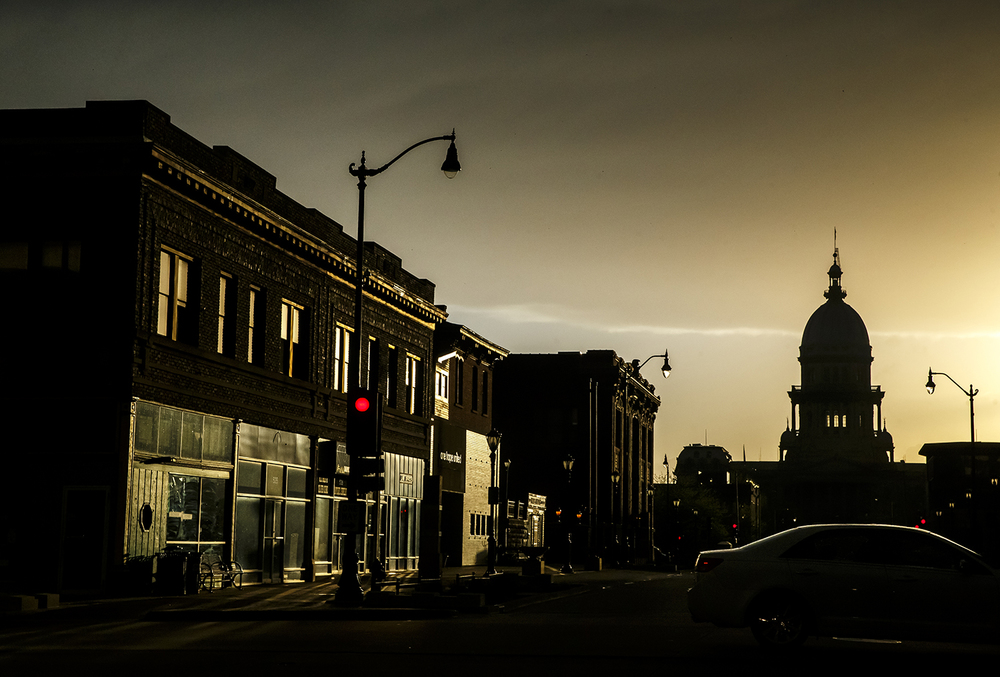 Storefronts on Capitol Avenue are lit by the setting sun April 28, 2014. Justin L. Fowler/The State Journal-Register