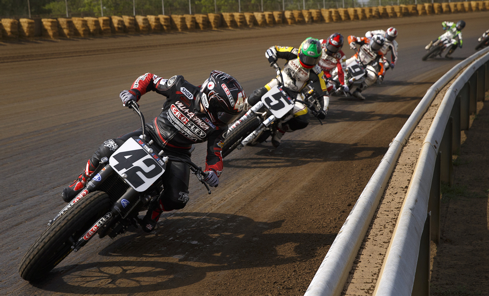 Bryan Smith looks at the traffic behind him as he comes out of turn four leading the AMA Pro Flat Track Grand National Championship Springfield Mile at the Illinois State Fairgrounds Sunday, May 25, 2014. Smith led 20 of 25 laps. Ted Schurter/The State Journal-Register