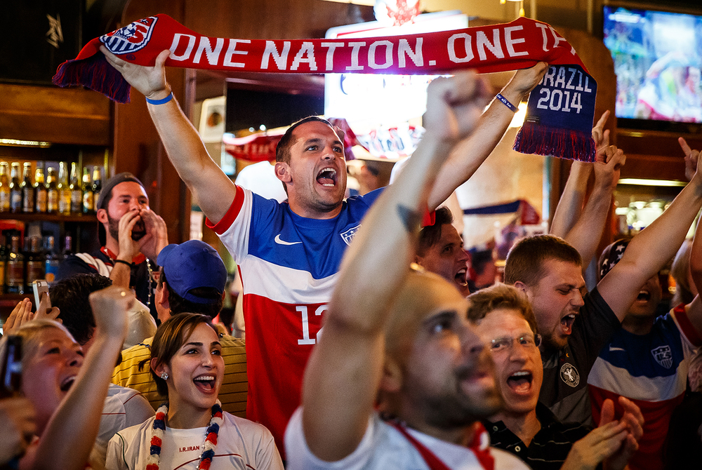 Zach Rambach, a group director of the Land of Lincoln chapter of the American Outlaws, celebrates a goal by USA to put them up 1-0 against Ghana in the first half of their World Cup match during a viewing party hosted by the group at The Alamo, Monday, June 16, 2014, in Springfield, Ill. Justin L. Fowler/The State Journal-Register