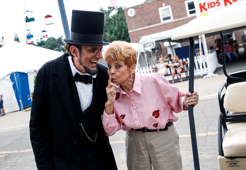 State Comptroller Judy Baar Topinka jokes with George Buss, as Abraham Lincoln, that at one point the State's Blue Book had a typo that listed her serving with Abraham Lincoln during the Local Official's Day presentation at the Illinois State Fairgrounds, Saturday, Aug. 9, 2014, in Springfield, Ill. Justin L. Fowler/The State Journal-Register