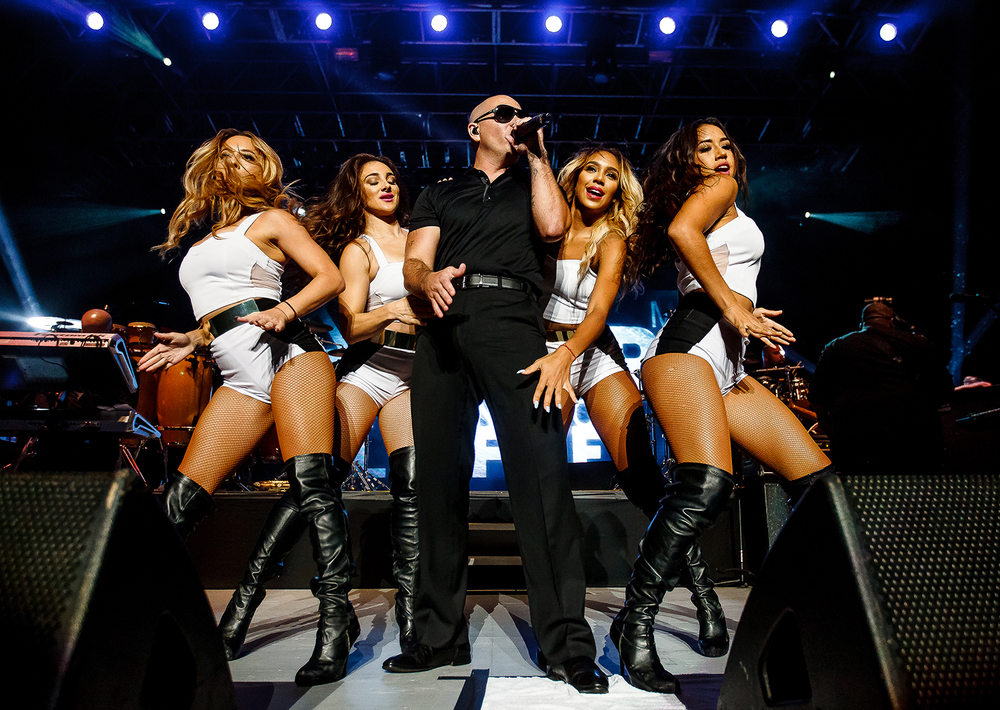 "Pitbull is surrounded by his dancers as he performs ""International Love"" on the Grandstand stage at the Illinois State Fairgrounds, Saturday, Aug. 9, 2014. Justin L. Fowler/The State Journal-Register"