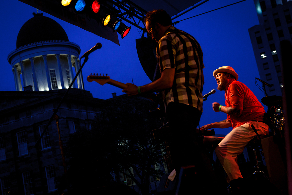 "Josh Hoyer, right, and The Shadow Boxers perform the song ""The First One"" during the 2014 Old Capitol Blues & BBQ on Fifth and Washington streets, Friday, Aug. 22, 2014, in Springfield, Ill. Justin L. Fowler/The State Journal-Register"
