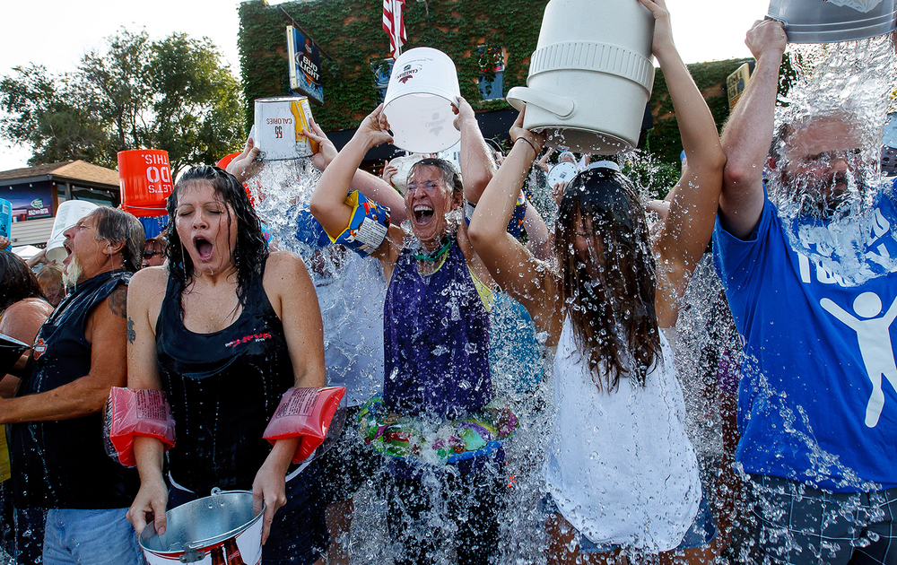 Nicole Dineen, left, Kristin Delfino, and Nicole Berg, react after taking the ALS Ice Bucket Challenge at the The Curve Inn, Tuesday, Aug. 19, 2014. The group event was to help to raise awareness and money for amyotrophic lateral sclerosis, also known as Lou Gehrig's disease. Justin L. Fowler/The State Journal-Register