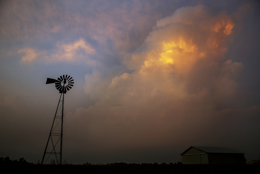 Sun reflects off the clouds southwest of Auburn as heavy clouds roll in Thursday, Aug. 28, 2014. Ted Schurter/The State Journal-Register