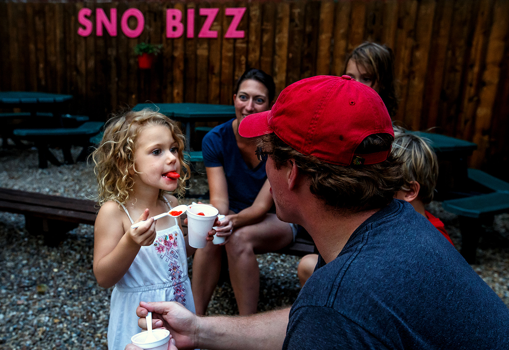 "Avery Musick, 3, gets a status check of what color her tongue is from her father, Ken Musick, right, as the family enjoys a round of snow cones and ice cream at Sno Bizz on West Laurel Street, Thursday, Aug. 28, 2014, in Springfield, Ill. ""It's just one of those evenings where it sounded good,"" said Angie Musick, Avery's mother. Justin L. Fowler/The State Journal-Register"