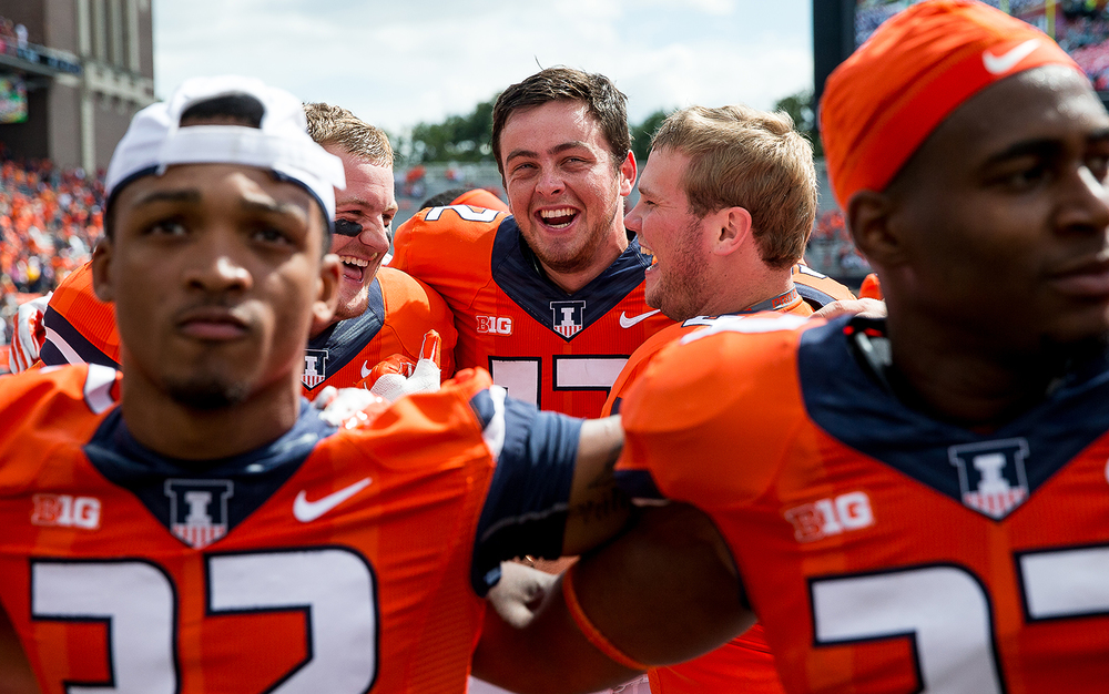 Illinois Fighting Illini quarterback Wes Lunt celebrates with his teammates after Illinois defeated the Western Kentucky Hilltoppers 42-34 at Memorial Stadium, Saturday, Sept. 6, 2014, in Champaign. Justin L. Fowler/The State Journal-Register
