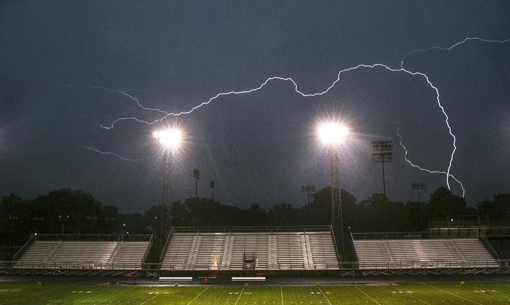 Lightning streaks across the sky above Memorial Stadium, delaying the start of the Lanphier football game Friday, Sept. 5, 2014.  Ted Schurter/The State Journal-Register