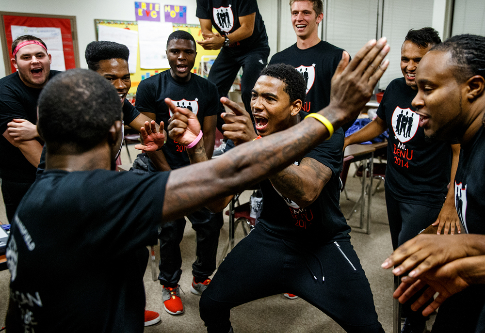 Senior Wynn Adams, center, takes the spotlight as the contestants dance in a group to get pumped up prior to the start of the Mr. Benedictine contest during the homecoming festivities for Benedictine University at Springfield at Angela Hall, Thursday, Oct. 16, 2014, in Springfield, Ill. Justin L. Fowler/The State Journal-Register