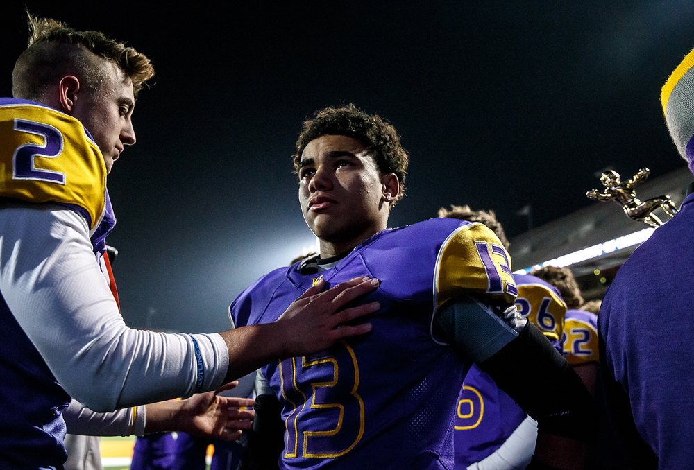 Williamsville's Jace Franklin (13) is comforted by Cole Courson (2) after the Bullets were defeated by Wilmington 20-17 in the IHSA Class 3A state championship game at Memorial Stadium, Friday, Nov. 28, 2014, in Champaign, Ill. Justin L. Fowler/The State Journal-Register
