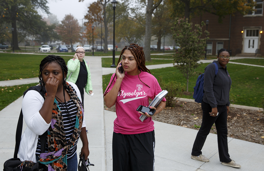 Benedictine University students Patience Blair, left, and Tierra Alvey react to news Friday, Oct. 24, 2014 that the university is ending its undergraduate program in May, as announced at an all-school meeting with President Michael Bromberg. Rich Saal/The State Journal-Register