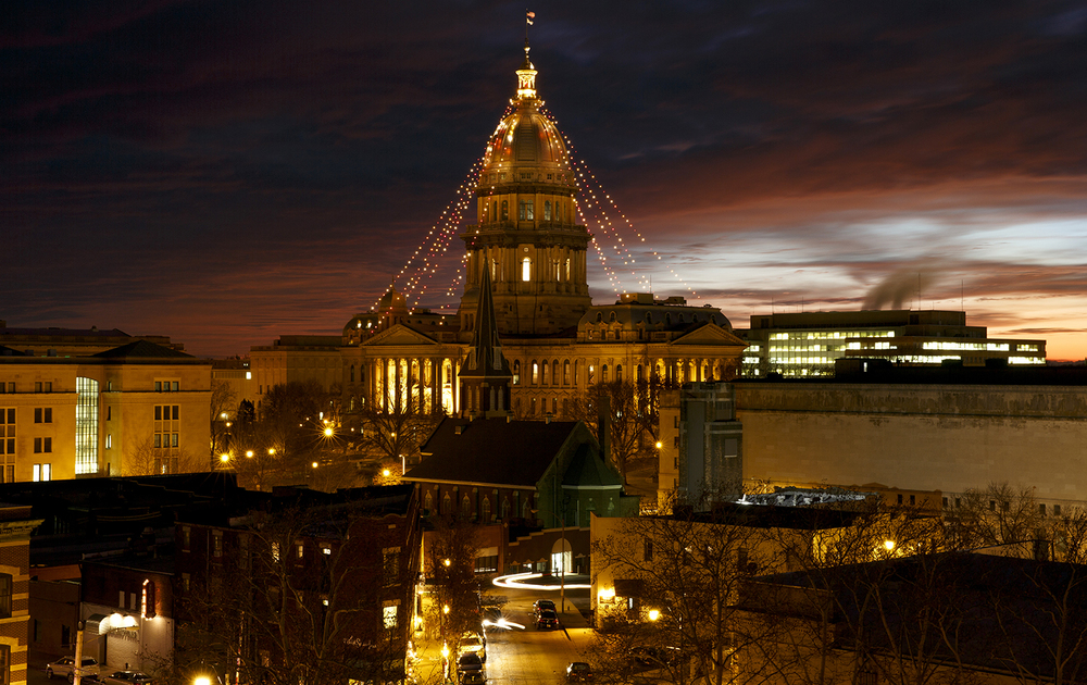 Christmas lights on the State Capitol dome complement a fiery sunset Tuesday, Dec. 23, 2014. Rich Saal/The State Journal-Register