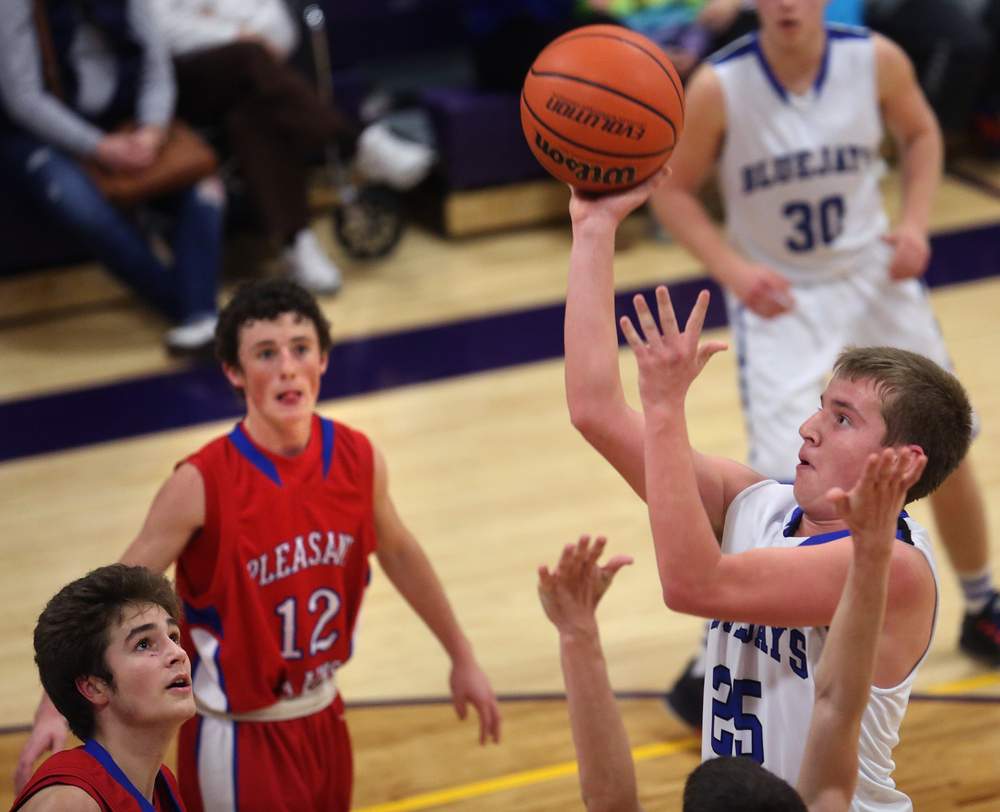 Bluejays player Seth Rebbe puts in two points late in the second half Saturday. Petersburg PORTA defeated Pleasant Plains 58-50 on the second day of action at the Williamsville Holiday basketball tournament at Williamsville High School on Saturday, Dec. 27, 2014. David Spencer/The State Journal-Register