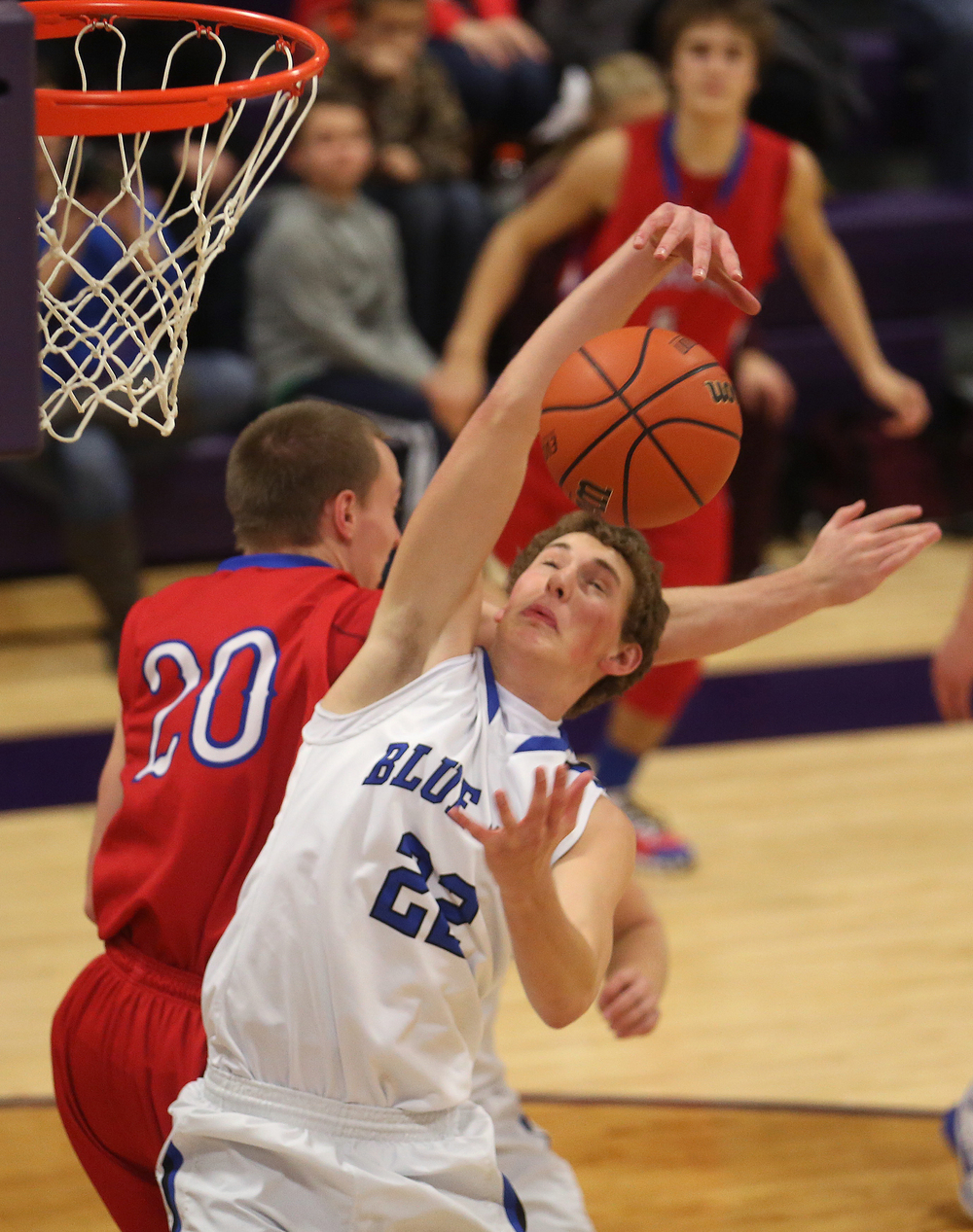 Fighting for a rebound during first half action are Bluejay player Max Muller and Cardinals player Dylan Bee. Petersburg PORTA defeated Pleasant Plains 58-50 on the second day of action at the Williamsville Holiday basketball tournament at Williamsville High School on Saturday, Dec. 27, 2014. David Spencer/The State Journal-Register