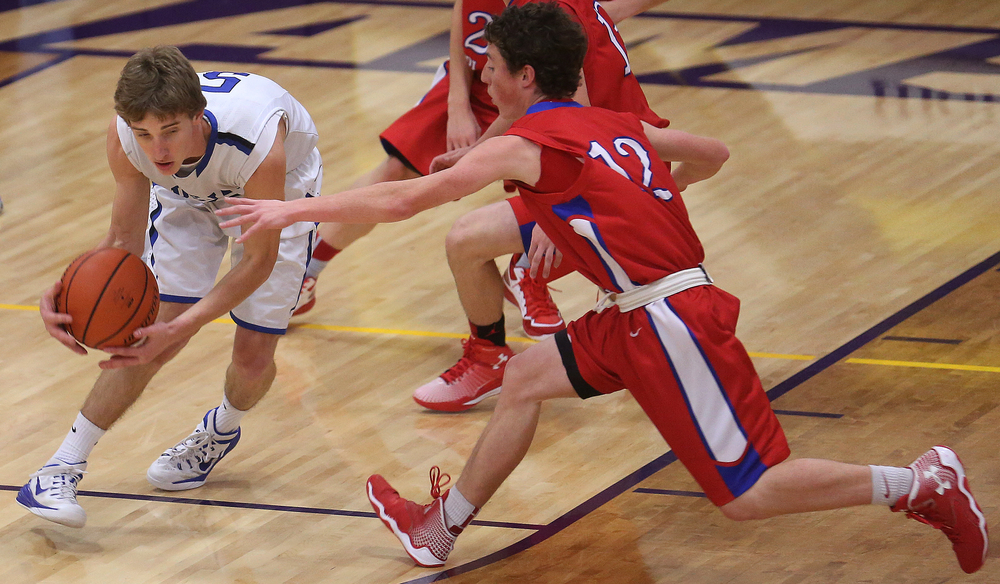 Bluejays player Matt Muller tries to gain control of the ball under pressure from Cardinals player Daulton Nibbe. Petersburg PORTA defeated Pleasant Plains 58-50 on the second day of action at the Williamsville Holiday basketball tournament at Williamsville High School on Saturday, Dec. 27, 2014. David Spencer/The State Journal-Register