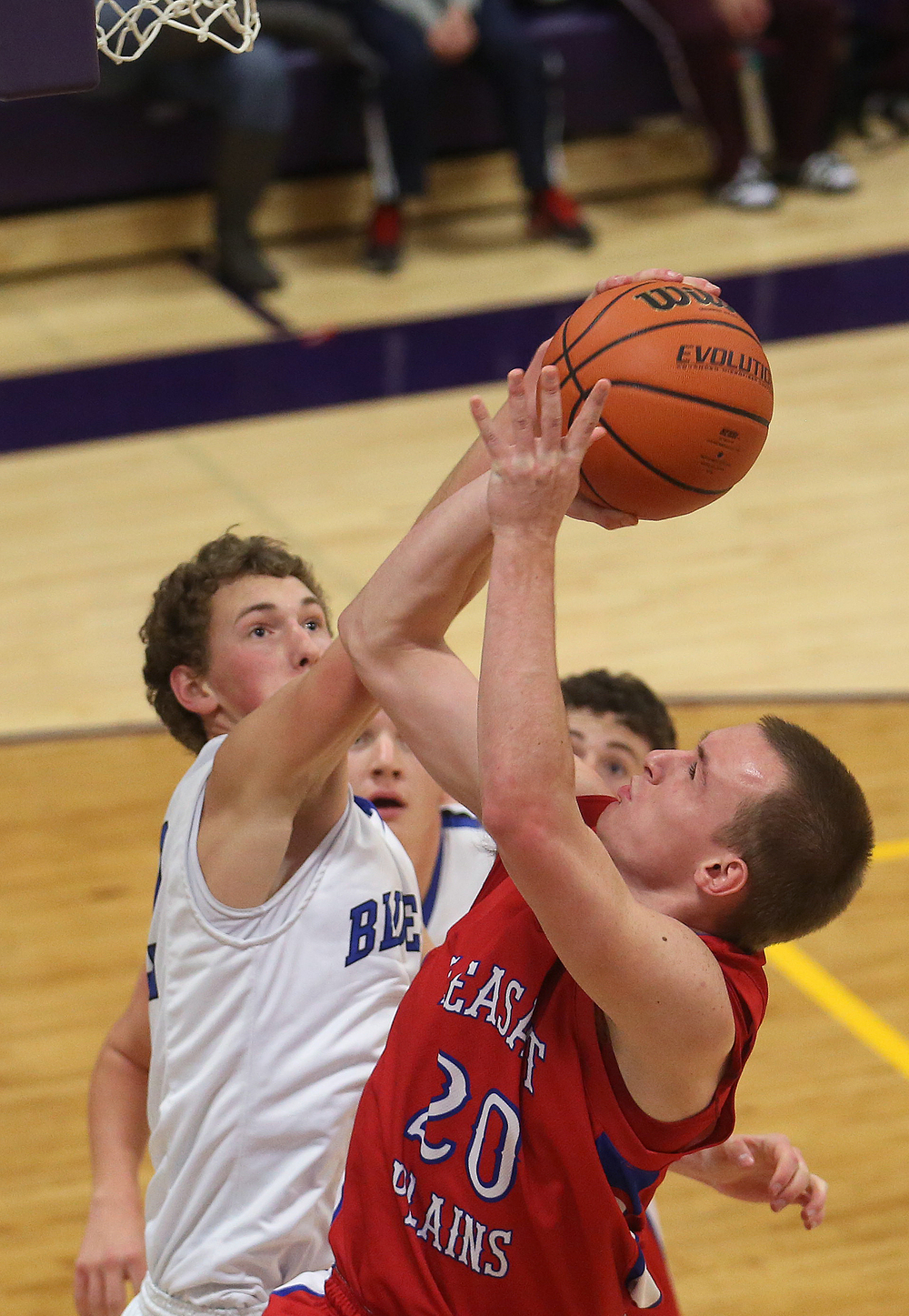 Bluejays defender Max Muller blocks a shot by Cardinals player Dylan Bee. Petersburg PORTA defeated Pleasant Plains 58-50 on the second day of action at the Williamsville Holiday basketball tournament at Williamsville High School on Saturday, Dec. 27, 2014. David Spencer/The State Journal-Register