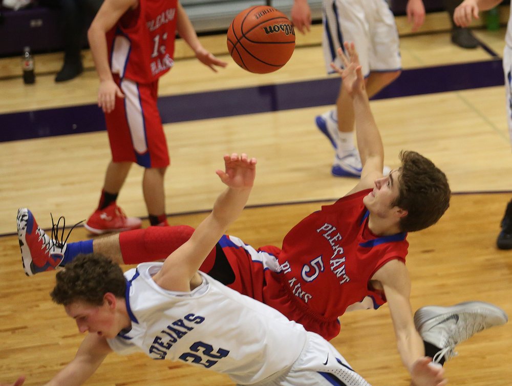 Cardinals player Landon Davis and Bluejays player Max Muller collide while going for a rebound under the net. Petersburg PORTA defeated Pleasant Plains 58-50 on the second day of action at the Williamsville Holiday basketball tournament at Williamsville High School on Saturday, Dec. 27, 2014. David Spencer/The State Journal-Register