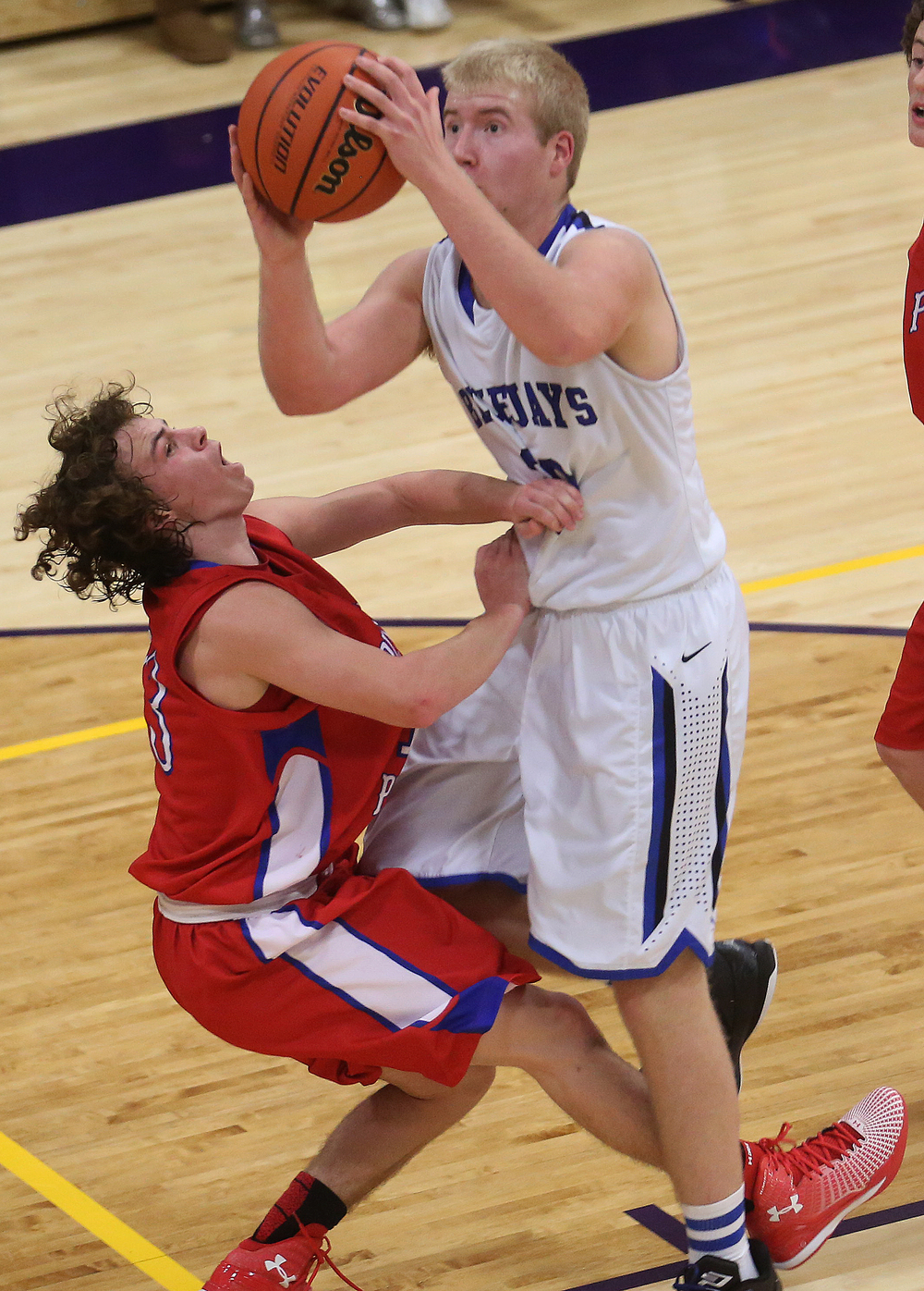 In second half action, Bluejays player Michael McCurdy prepares to put up two points while Cardinals defender Cole Greer puts on the pressure. Petersburg PORTA defeated Pleasant Plains 58-50 on the second day of action at the Williamsville Holiday basketball tournament at Williamsville High School on Saturday, Dec. 27, 2014. David Spencer/The State Journal-Register