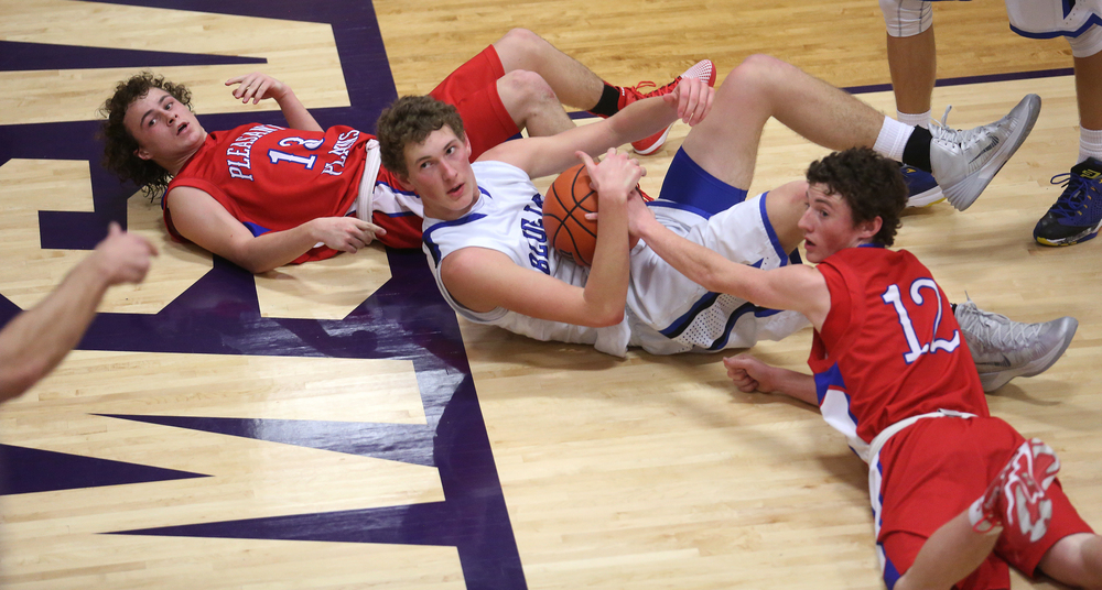 Looking to the official for a decision-made in the Cardinals favor-are Blujays player Max Muller at center flanked by Cardinal players Cole Greer at left and Daulton Nibbe. Petersburg PORTA defeated Pleasant Plains 58-50 on the second day of action at the Williamsville Holiday basketball tournament at Williamsville High School on Saturday, Dec. 27, 2014. David Spencer/The State Journal-Register