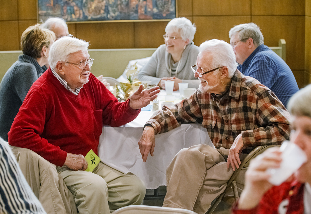 Burnell Heinecke, left, and Larry Wedding visit after having breakfast at the 11th Annual Temple B'rith Sholom Holiday Interfaith Breakfast Thursday, Dec. 25, 2014. More than 300 people attended the holiday fundraiser. Ted Schurter/The State Journal-Register