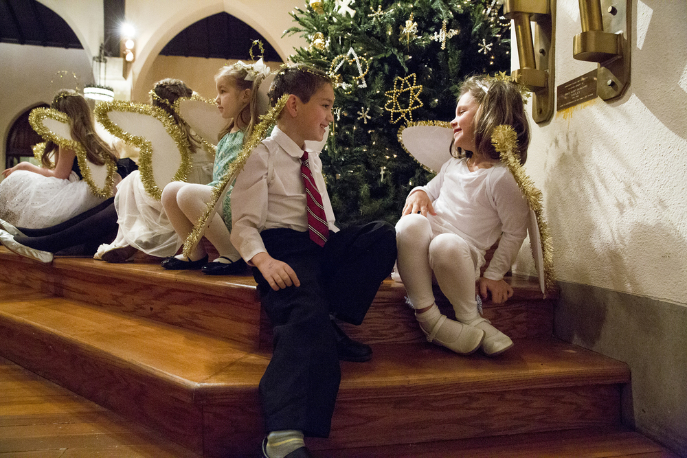 Ben Bassett and Maria DeJong, who portrayed angels for the Christmas Eve children's service at Westminster Presbyterian Church, were tempted to talk during the production Wednesday, Dec. 24, 2014. Children from the confirmation and Sunday School classes told the story of the birth of Jesus. Rich Saal/The State Journal-Register