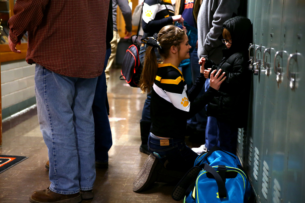 Edinburg cheerleader Olivia Agnew, 14, left, tickles her cousin Matthew, 6, as he gets bundled up for the cold after the Edinburg vs. Tri-City game during 64th annual Waverly Holiday Tournament at Waverly Grade School, Monday, Dec. 29, 2014, in Waverly , Ill. Justin L. Fowler/The State Journal-Register