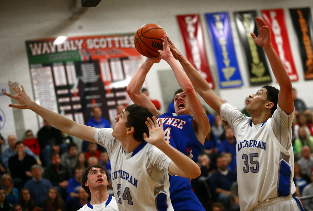 Pawnee's Cade Puzey (24) has his shot blocked by Lutheran's Pierson Wofford (35) in the first half during the semifinals of the 64th annual Waverly Holiday Tournament at Waverly Grade School, Monday, Dec. 29, 2014, in Waverly , Ill. Justin L. Fowler/The State Journal-Register