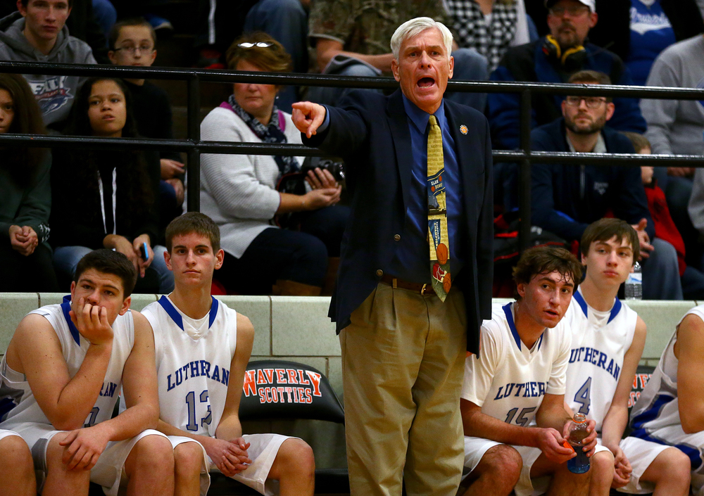 Lutheran head boys basketball coach Steve Allen calls out instructions to his players as they take on Pawnee in the first half during the semifinals of the 64th annual Waverly Holiday Tournament at Waverly Grade School, Monday, Dec. 29, 2014, in Waverly , Ill. Justin L. Fowler/The State Journal-Register