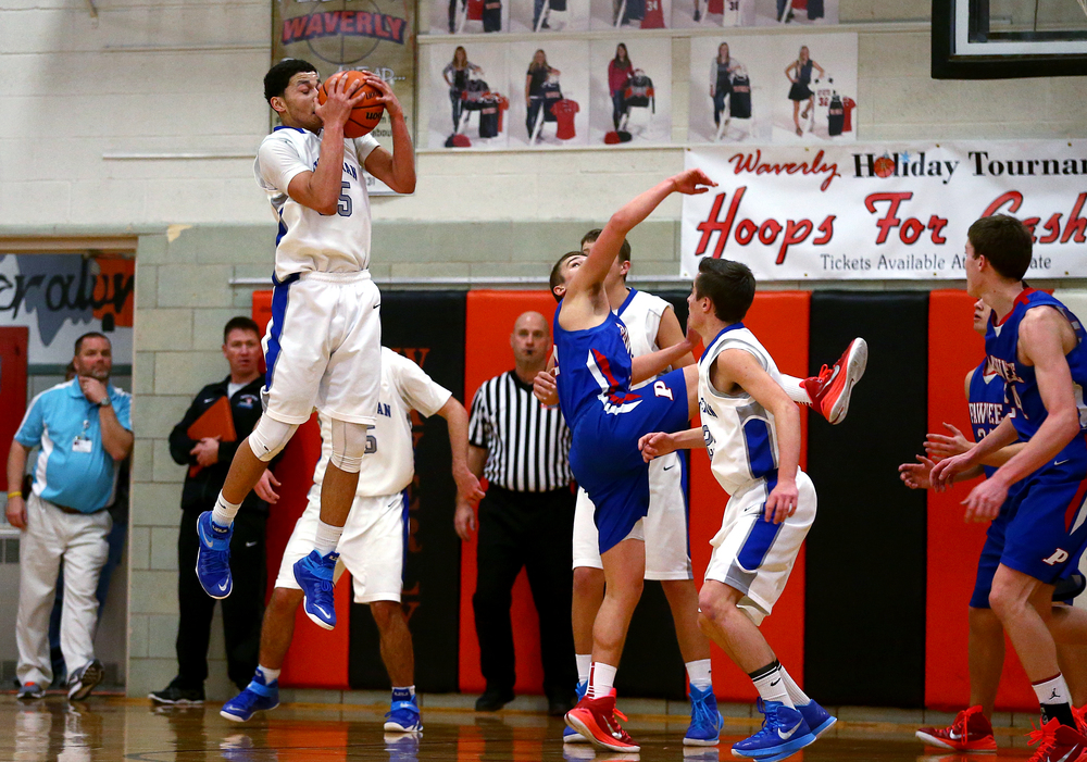 Lutheran's Pierson Wofford (35) pulls in a rebound against Pawnee in the second half during the semifinals of the 64th annual Waverly Holiday Tournament at Waverly Grade School, Monday, Dec. 29, 2014, in Waverly , Ill. Justin L. Fowler/The State Journal-Register