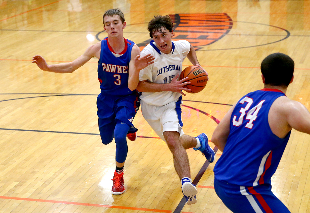 Lutheran's Adam Forestier (15) drives towards the basket against Pawnee's Garrett Gillette (3) in the second half during the semifinals of the 64th annual Waverly Holiday Tournament at Waverly Grade School, Monday, Dec. 29, 2014, in Waverly , Ill. Justin L. Fowler/The State Journal-Register